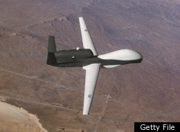 File Photo: The Global Hawk unmanned aerial vehicle displays its new paint scheme in this undated photo. The Hawk is a long-endurance, high-altitude unmanned aerial vehicle intended for multiple battlefield applications. It is capable of surveying an area the size of the state of IL, or 40,000 square miles, in just 24 hours. (Photo by USAF/Getty Images)