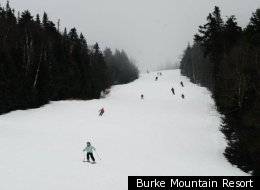 Skiers make their way down the hill at Burke Mountain Resort.