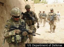 U.S. Army Sgt. 1st Class John Shimkus (left) on patrol with his platoon in Kandahar, Afghanistan, last year.