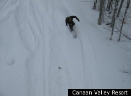 A snowboarder hits the slopes at Canaan Valley Resort.