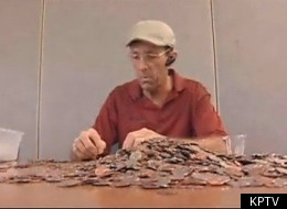 Dan Johnson Sr. seen sifting through coins to find the rare money that three burglars stole from him.