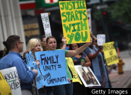 Protesters in Denver hold signs against the deportation of a Mexican immigrant in July of 2011.