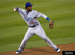 SAN DIEGO, CA - SEPTEMBER 26: Starlin Castro #13 of the Chicago Cubs fields the ball and throws to first base for the out during the first inning of the game against the San Diego Padres at Petco Park on September 26, 2011 in San Diego, California. (Photo by Kent C. Horner/Getty Images)