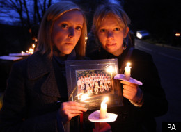 Charlotte Mayal (left) and Verity Worthiungton, former pupils of murder victim Betty Yates 77, hold a photo of their former teacher