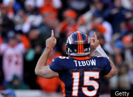 DENVER, CO - JANUARY 08: Tim Tebow #15 of the Denver Broncos celebrates after running the ball in the end zone for a touchdown in the second quarter against the Pittsburgh Steelers during the AFC Wild Card Playoff game at Sports Authority Field at Mile High on January 8, 2012 in Denver, Colorado. (Photo by Jeff Gross/Getty Images)