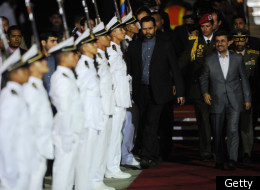 Iranian President Mahmoud Ahmadinejad (R) is welcomed with military honours at Maiquetia international airport in Caracas, on January 8, 2011 where he arrived to start a five-day tour aimed at shoring up ties in Latin America. (Getty)