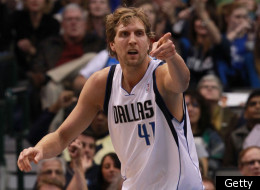 DALLAS, TX - JANUARY 04: Dirk Nowitzki #41 of the Dallas Mavericks reacts after scoring against the Phoenix Suns at American Airlines Center on January 4, 2012 in Dallas, Texas. Nowitzki was playing in his 1,000 career game.