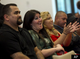 """Melissa Pirraglio, second from left, applauds during the graduation ceremony of the Los Angeles Violence Intervention Training Academy (LAVITA) in Los Angeles, Tuesday, Dec. 20, 2011. Pirraglio spent many of her 11 years of gang life in drug-addled despair seeking a way out. """"There's an inkling in every single gang member looking for an opportunity to come out,"""" said Pirraglio, now 34 and a counselor to troubled youth. (AP Photo/Jae C. Hong)"""
