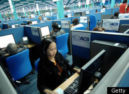 Workers at a Filipino call center handling calls from American customers.