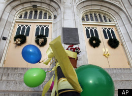 Yellow ribbons, signs and balloons, adorn the front of Saint Hubert's Catholic High School for girls after a protest Monday, Jan. 9, 2012, in Philadelphia. Students gathered to voice opposition for an archdiocese closure and consolidation plan that would shutter 48 schools including St. Hubert's. (AP Photo/Alex Brandon)