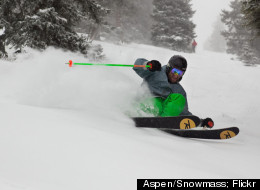 A skier cuts into some fresh powder at Aspen Mountain, part of the Aspen Snowmass complex.