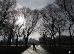 Pedestrians take advantage of the unseasonably warm temperatures and glide on two, three-wheel scooters, in Chicago's Grant Park, Friday, Jan. 6, 2012. (AP Photo/Charles Rex Arbogast)