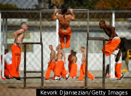 CHINO, CA - DECEMBER 10: Inmates at Chino State Prison exercise in the yard December 10, 2010 in Chino, California. (Photo by Kevork Djansezian/Getty Images)