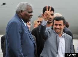 Iranian President Mahmoud Ahmadinejad (R) is welcomed by Cuban Vice-President Esteban Lazo upon his arrival at the Jose Marti international airport of Havana, on January 11, 2012. (Getty)