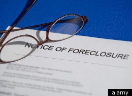 The number of homes with foreclosure filings plunged 34 percent to 1.89 million in 2011, according to RealtyTrac.