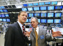 Securities and Exchange Commission Chairman Christopher Cox, left, is given a tour of one of the floors at the Chicago Board Options Exchange by William Brodsky, chairman and CEO of the CBOE on Tuesday, Nov. 8, 2005, in Chicago. Cox was in Chicago for a meeting with the leaders of all Chicago's exchanges. (AP Photo/M. Spencer Green)