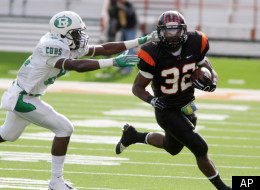 Aledo running back Johnathan Gray (32) runs past Brenham's Terrell Reese during the UIL Class 4A-Division 2 Football State Championship in Austin, Texas on Saturday, Dec. 19, 2009. Aledo won 35-21. (AP Photo/Jack Plunkett)