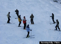 An Elk Mountain instructor teaches the basics to a class of skiers.