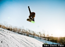 A snowboarder catches some huge air at Le Relais.