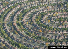 An aerial view of houses in the suburb of north east London, England. (Jason Hawkes)