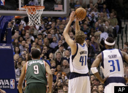Dallas Mavericks power forward Dirk Nowitzki (41) of Germany shoots a free throw in the first half of an NBA basketball game against the Milwaukee Bucks Friday, Jan. 13, 2012, in Dallas. The shot gave Nowitzki his 23, 001 career point. (AP Photo/Tony Gutierrez)