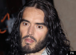 Russell Brand has flown back to the US for the first time since his split was announced