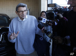 FILE - In this Nov. 8, 2011, file photo, Penn State football coach Joe Paterno leaves the Louis and Mildred Lasch Football Building on campus in State College, Pa. Paterno was later fired in the aftermath of child sex-abuse charges against former defensive coordinator Jerry Sandusky. (AP Photo/Matt Rourke, File)