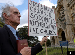 An evangelical demonstrator protests outside of Jeffrey John's church in 2003.
