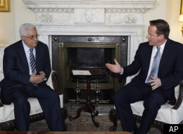 Britain's Prime Minister David Cameron, right, speakswith Palestinian Authority President Mahmoud Abbas, left, prior to their meeting at his official residence at 10 Downing Street in central London, Monday, Jan. 16, 2012. (AP)