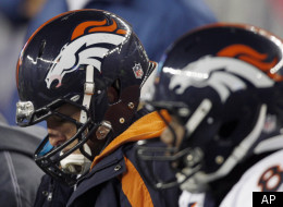 Denver Broncos quarterback Tim Tebow, left, sits on the bench during the second half of an NFL divisional playoff football game against the New England Patriots Saturday, Jan. 14, 2012, in Foxborough, Mass. (AP Photo/Charles Krupa)