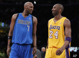 Dallas Mavericks' Lamar Odom, left, interacts with Los Angeles Lakers' Kobe Bryant, right, as they come back to the court after a time out in the first quarter of an NBA basketball game in Los Angeles on Monday, Jan. 16, 2012. (AP Photo/Danny Moloshok)