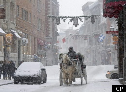 A horse-drawn carriage makes its way down a street in Old Montreal during a snowfall on Jan. 12.