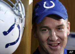 Indianapolis Colts quarterback Peyton Manning talks to reporters in the locker room at the NFL football team's practice facility in Indianapolis, Friday, Dec. 2, 2011. (AP Photo/Michael Conroy)