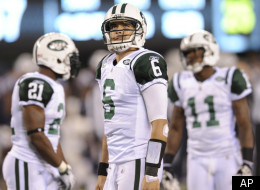 New York Jets quarterback Mark Sanchez (6) looks on with teammates LaDainian Tomlinson (21) and Jeremy Kerley (11) during the fourth quarter of an NFL football game, Sunday, Nov. 13, 2011, in East Rutherford, N.J. The Jets lost the game 37-16. (AP Photo/Bill Kostroun)