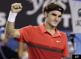 Switzerland's Roger Federer celebrates after defeating Australia's Bernard Tomic during their fourth round match at the Australian Open tennis championship in Melbourne, Australia, Sunday, Jan. 22, 2012. (AP Photo/Sarah Ivey)