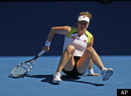 Belgium's Kim Clijsters falls over during her fourth round match against China's Li Na at the Australian Open tennis championship in Melbourne, Australia, Sunday, Jan. 22, 2012. (AP Photo/Aaron Favila)