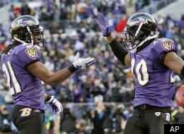 Baltimore Ravens free safety Ed Reed celebrates his interception with cornerback Lardarius Webb, left, during the second half of an NFL divisional playoff football game against the Houston Texans in Baltimore, Sunday, Jan. 15, 2012. The Ravens defeated the Texans 20-13. (AP Photo/Patrick Semansky)