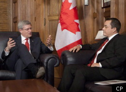 Prime Minister Stephen Harper gestures as he sits down to speak with Assembly of First Nations Chief Shawn Atleo in his office on Parliament Hill in Ottawa Thursday December 1, 2011. (CP)