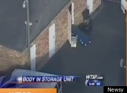 Police remove a blue casket containing a woman's remains from a storage unit in Clearwater, Fl.