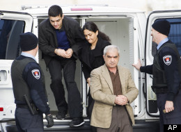 Mohammad Shafia, front, Tooba Yahya, center, and their son Hamed Shafia, back left, are escorted at the Frontenac County courthouse in Kingston, Ontario, Canada on Saturday, Jan. 28, 2012. They were accused of killing Shafia sisters Zainab, 19, Sahar, 17, and Geeti, 13, as well as Rona Amir Mohammad, 52, their father's childless first wife in a polygamous marriage. (AP Photo/The Canadian Press, Nathan Denette)
