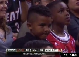 Carlos Boozer's son was on camera cheering against his Dad's team on Sunday.
