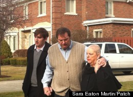 Bob Bashara, center, with his son and mother before speaking to the media outside his home Feb. 1.