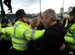 Climate change protesters confront police near the Ratcliffe-on-Soar power station in 2009