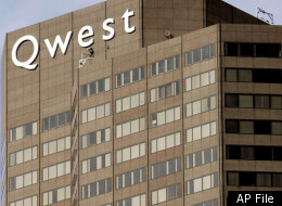 The former Qwest Communications International Inc. tower is pictured in a Denver on Tuesday, Feb. 14, 2006. Qwest Communications International Inc., one of the nation's largest phone companies, posted a wider fourth-quarter loss on one-time items. But results excluding items topped Wall Street estimates on improved revenue, margins and cash flow. Qwest earnings were released Tuesday. (AP Photo/Ed Andrieski)
