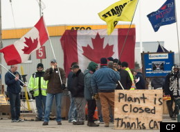 CAW workers picket outside at the Electro-Motive plant in London, Ont., on Friday, feb. 3, 2012. American-based heavy equipment maker Caterpillar Inc. announced Friday it was closing the plant, a month after it locked out about 450 workers. THE CANADIAN PRESS/Mark Spowart