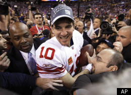 New York Giants quarterback Eli Manning celebrates after the Giants' 21-17 win over the New England Patriots in the NFL Super Bowl XLVI football game, Sunday, Feb. 5, 2012, in Indianapolis. (AP Photo/Paul Sancya)