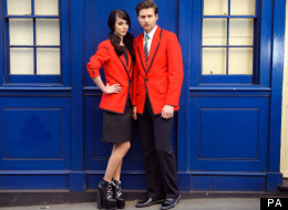 An unnamed male model and up and coming British designer Hannah Clayton, left, during the launch of the New Redcoat uniforms for Butlins
