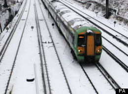 Trains in East Anglia (not pictured) have been affected by poor weather, as have those across south London, above.