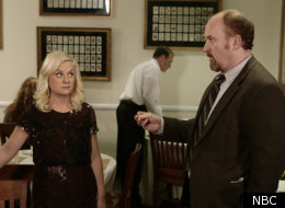 Amy Poehler and Louis C.K. in an episode of
