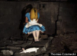 Lifeless: Alice is no longer in Wonderland...slumped in her chair with the white rabbit lying dead at her feet